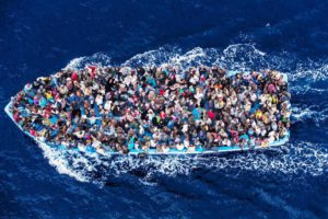 4/Hundreds of refugees and migrants aboard a fishing boat are pictured moments before being rescued by the Italian Navy as part of their Mare Nostrum operation in June 2014. Among recent and highly visible consequences of conflicts around the world, and the suffering they have caused, has been a dramatic growth in the number of refugees seeking safety by undertaking dangerous sea journeys, including on the Mediterranean. The Italian Coastguard / Massimo Sestini